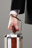 Case attached to hand with handcuffs Stock Images