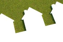Case bianche con un fondo dell'erba del prato inglese Immagini Stock