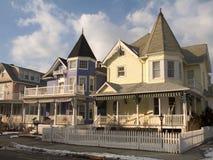 Case della rete fissa e del Victorian di picchetto Immagine Stock Libera da Diritti