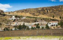 Case di abitazioni in roccia a Puerto Lumbreras fotografia stock libera da diritti