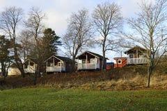 Case di estate di legno di fila in autunno Fotografia Stock Libera da Diritti