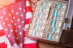 Case with dollars beside flag. Stock Photo