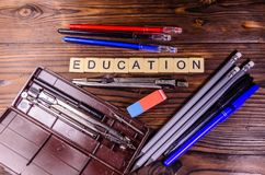 Case of drawing instruments, pencils and eraser on wooden table. Royalty Free Stock Photo