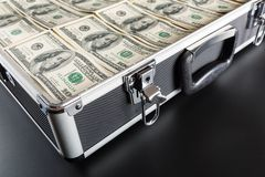 Case full of money on gray background Royalty Free Stock Photography