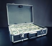 Case full of money on gray background Royalty Free Stock Photos