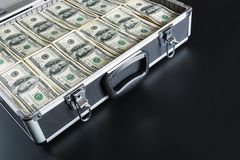 Case full of money on gray background Royalty Free Stock Photo