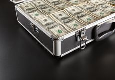 Case full of money on gray background Stock Images