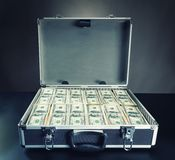 Case full of money on gray background Stock Image