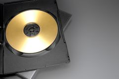 Case and golden disk. Open CD/DVD case with a golden disk Stock Images