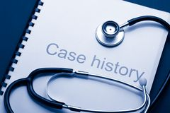 Case history. And stethoscope on black Stock Image