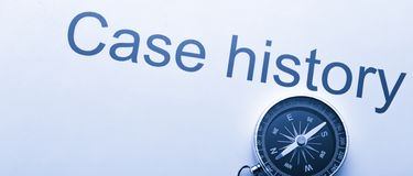 Case history and compass Stock Photo