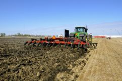 Case IH chisel plow and John Deere tractor Stock Image