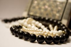 Case with jewellery. This is a case with jewellery, beads and pearl Stock Photography