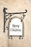 Case la Navidad en una vieja muestra del hierro labrado Foto de archivo