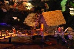Case miniatura nella greppia di natale Fotografia Stock Libera da Diritti