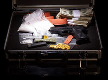 Case with money, gun and drugs Royalty Free Stock Image