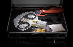 Case with money, gun and drugs Stock Photos