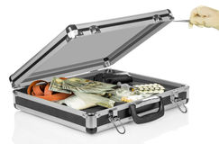 Case with money, gun and drugs Stock Image