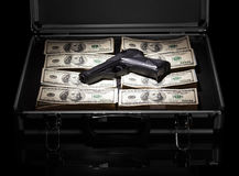 Case with money and gun Stock Photos