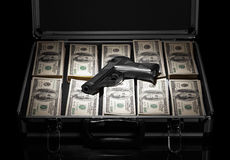 Case with money and gun Royalty Free Stock Photo