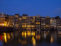 Case olandesi sul Damrak a Amsterdam Immagine Stock