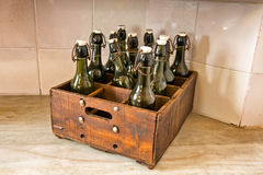 Case of Old Bottles on Counter in Casa Mila Stock Images