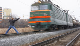 Case on railway. (madman thinking that train can stop now stock images