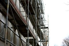 Steel scaffolding used for façade renovation works. stock photos