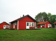 Case rosse svedesi tipiche Immagine Stock
