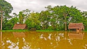 Case sommerse durante l'alta marea Immagine Stock