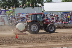 Case Tractor watering the track Royalty Free Stock Photos