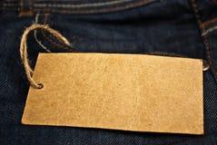 Casella dei jeans con la modifica in bianco immagini stock