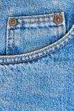 Casella dei pantaloni delle blue jeans come priorità bassa Fotografia Stock