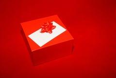 Casella rossa su colore rosso Fotografia Stock Libera da Diritti