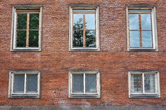Casement windows in red brick wall Royalty Free Stock Photos