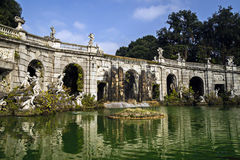 Caserta Royal Palace and his gardens. Fountain with statues and water  reflections Royalty Free Stock Images
