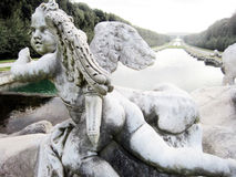 Caserta royal palace statue. View Of Caserta Royal Palace, Caserta, Italy. cupid Royalty Free Stock Photos