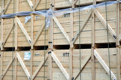 Cases of goods. Stock of heavy goods in wooden cases on a truck as background Stock Images