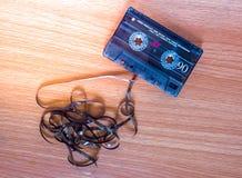 Casete de cinta en la madera Fotos de archivo libres de regalías