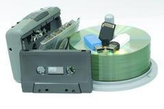 Casetes y CD en el fondo blanco Imágenes de archivo libres de regalías