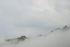 Casetta in nubi Immagine Stock