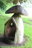 Casetta per giocare di legno del fungo Fotografia Stock