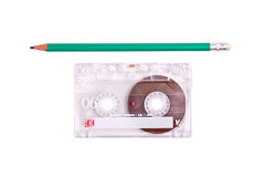 Casette tape with pencil. Concept of winding a cassette tape with a pencil Royalty Free Stock Images