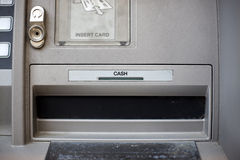 Cash. ATM detail with focus on cash dispenser Royalty Free Stock Image