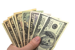 Cash. Dollars in the hand on white Stock Photos
