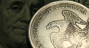 Cash. One dollar coin and one hundred dollars bill as a background Stock Photography