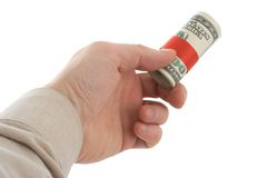 Cash. Hand holding roll of dollars Stock Images