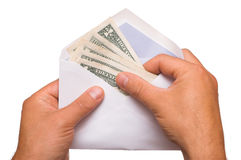 Cash. Human hands is counting a cash in an envelope on white Royalty Free Stock Photography
