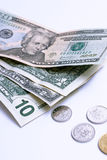 Cash. Us dollar bills and coins detail. Focus in center Royalty Free Stock Images