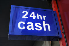 Cash all day and night Stock Photo